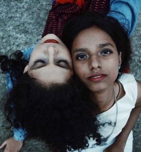 two women sits on gray soil taken
